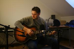 Bjørn Lynne with acoustic guitar